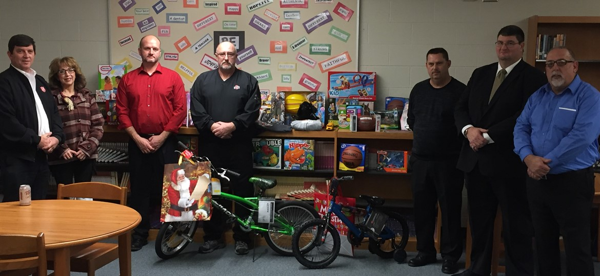 The Board of Education makes a donation of Christmas toys to the Salvation Army