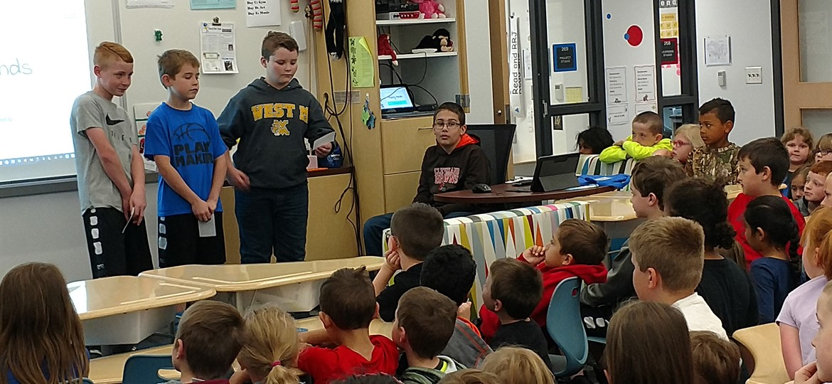 Fifth grade visits the first grade to discuss poverty and their helping hands project